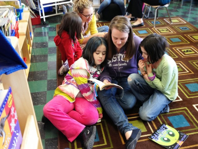 Reading Buddies Get Comfortable at the Amigos School