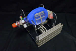 machine with blue bag, metal parts.
